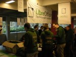 Green people manning the LibreOffice FOSDEM booth